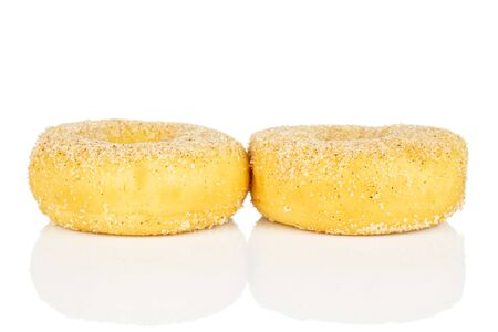 Group of two whole sweet golden mini cinnamon donut isolated on white background