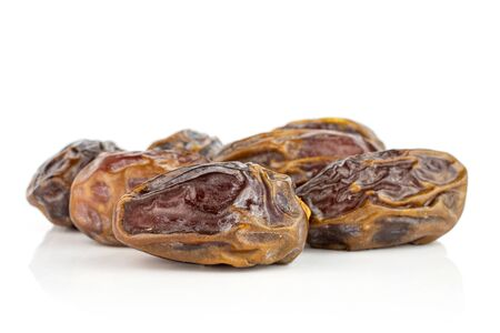 Lot of whole dry brown date fruit isolated on white background Reklamní fotografie