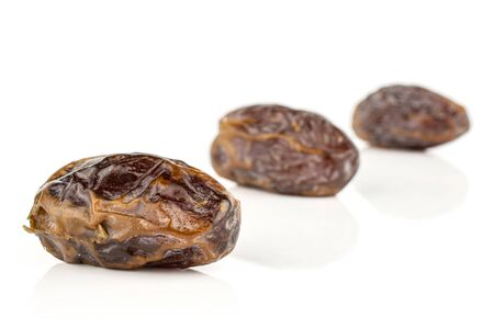 Group of three whole dry brown date fruit placed diagonally isolated on white background Reklamní fotografie
