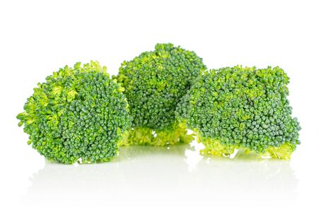 Group of three whole fresh green broccoli head isolated on white background