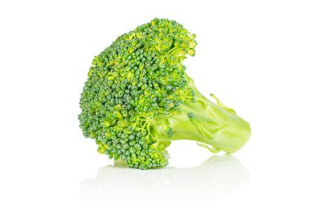 One whole fresh green broccoli head isolated on white background Фото со стока