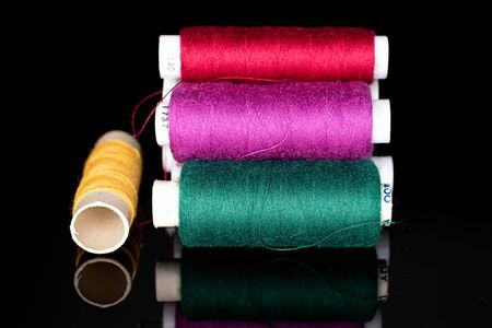 Lot of whole thread spool isolated on black glass Stock Photo