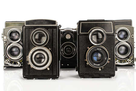 Group of five whole vintage camera isolated on white background