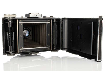 One whole opened vintage camera isolated on white background