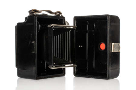 One whole open vintage camera isolated on white background