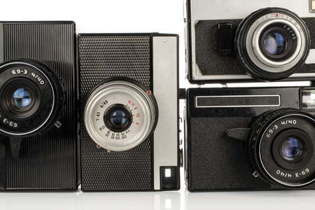 Group of four whole vintage camera isolated on white background