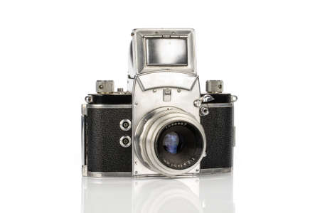 One whole silver vintage camera isolated on white background