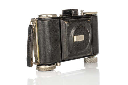 One whole black vintage camera isolated on white background