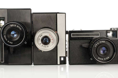 Group of three whole vintage camera isolated on white background