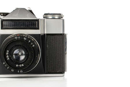 One whole arranged vintage camera isolated on white background