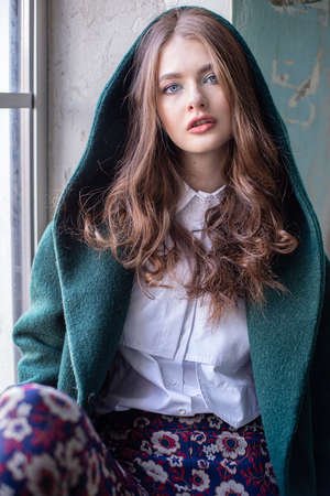 Young european woman portrait with window behind Reklamní fotografie