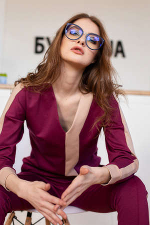 Girl in purple clothes with glasses portrait