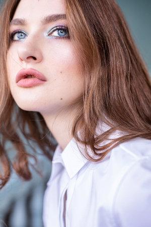 Young european woman brown hair closeup portrait Reklamní fotografie
