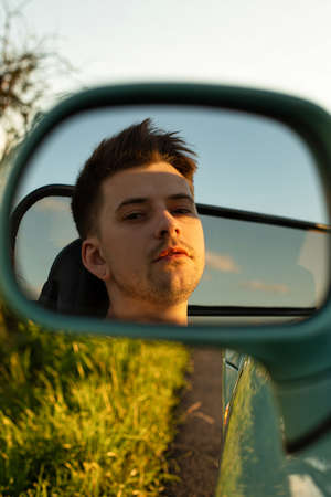 White young european model boy outside reflection in the mirror