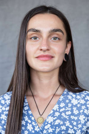 White european girl portrait isolated on dark grey in blue