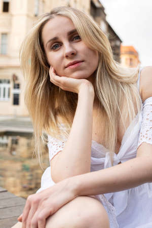 White european young model with a blonde hair portrait on the city street