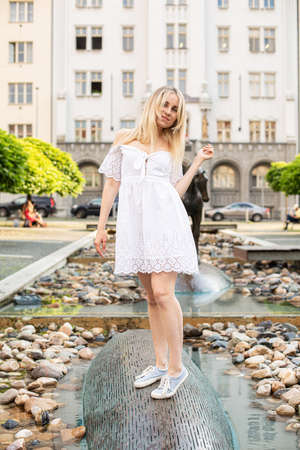 Walking white european young model with a blonde hair on the city street Standard-Bild