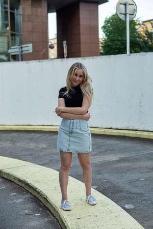 European young white girl walking near concrete underground parking Standard-Bild