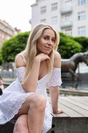 White european model with hand near the face on the city street Standard-Bild