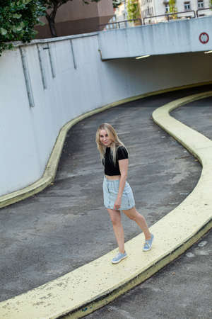 White european woman with blonde hair near underground parking Standard-Bild