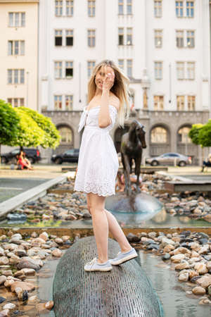 White european young model with a blonde hair on the city street