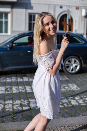 White european young model with a blonde hair smiling on the city street Standard-Bild