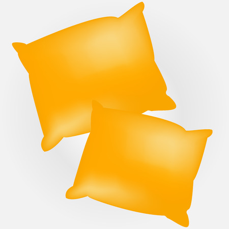 Two yellow empty and soft pillows. Template for your design. Stock Photo