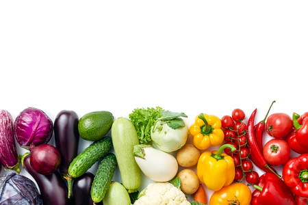 line made of different vegetables and berries isolated on white background. Copy space. Healthy eating background. Food photography. Top view