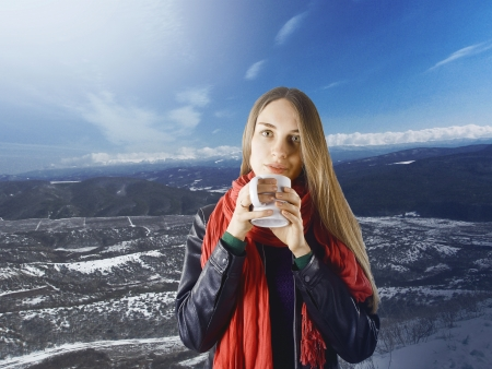 beautiful girl with a cup of tea on a winter landscape photo