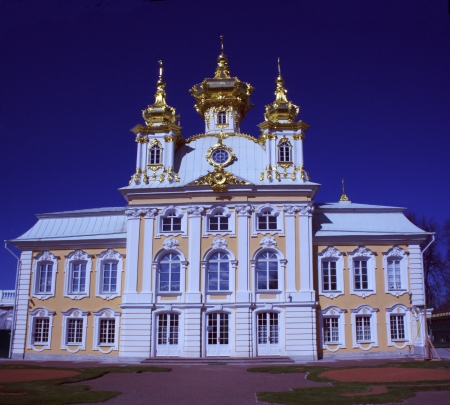 facade of a church in Peterhof, Tsarskoye Selo on the background of blue sky photo