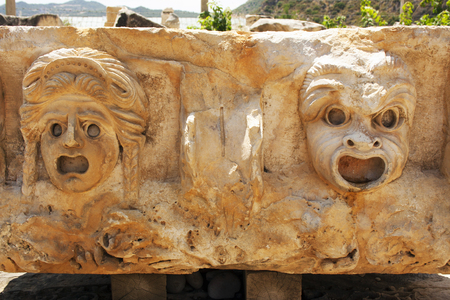 antik: face on the stone bas-reliefs in the ancient city Myra, Turkey
