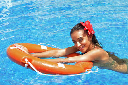 Beautiful woman in a swimming pool photo