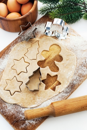 Kitchen utensil with raw Christmas cookies. Baking biscuits.  photo
