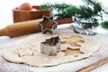 Kitchen utensil with raw Christmas cookies. Baking biscuits.  Stock Photo