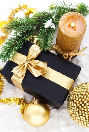 Golden Christmas composition with gift box, candle and branch of spruce Stock Photo - 23446013