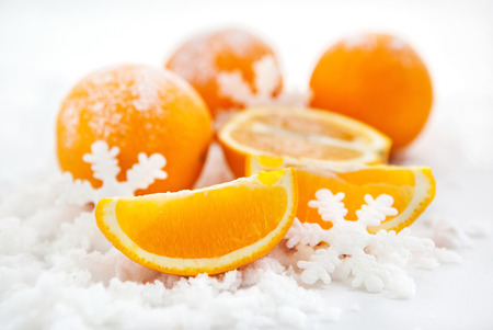 Oranges and slices of orange on the snow