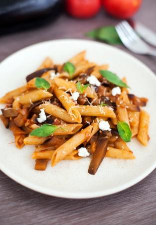 Pasta alla norma, italian recipe with tomato sauce, eggplant and ricotta cheese