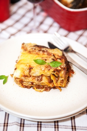 A piece of meat  and tomato lasagna (Lasagna Bolognese) on the plate  Stock Photo