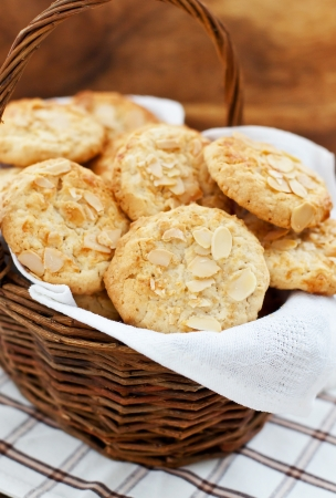 Oatmeal cookies with almond in a basket on a wooden  Archivio Fotografico