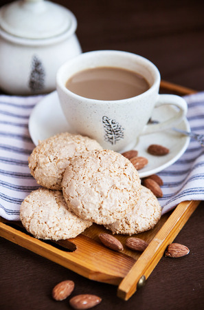 amaretto: Almond cookies (amaretti) and cup of coffee on the tray
