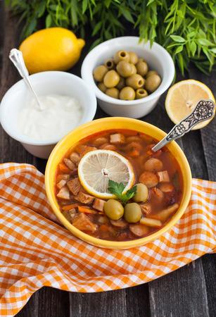 solyanka: Solyanka - russian soup with meat, sausage, olives and lemon