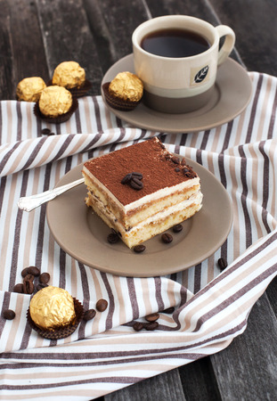 Portion of delicious tiramisu cake and coffee cup  Stock Photo