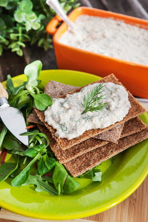 Fresh homemade herring creamy pate on a crispbread, ready to eat