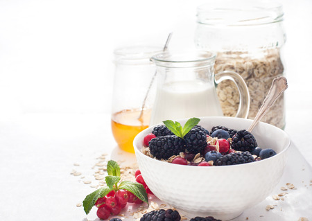 light breakfast: Healthy breakfast with granola and fresh berries on white Stock Photo