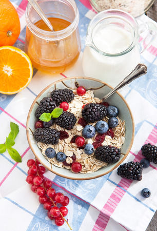 Healthy breakfast with granola and fresh berries photo