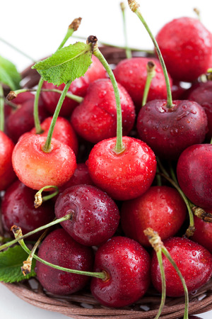 Fresh wet cherry in a basket, close up