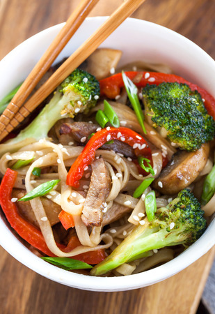 Udon noodles with meat, mushrooms and vegetables
