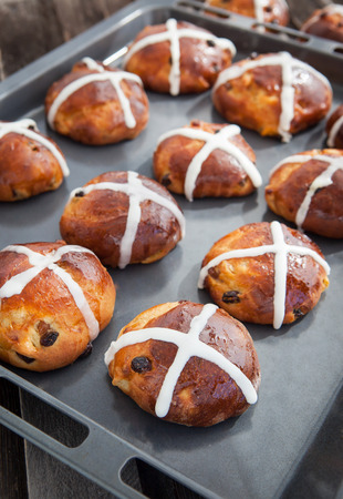 Easter hot cross buns on a baking sheet