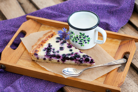 Piece of fresh homemade blueberry pie and milk on the tray Stock Photo
