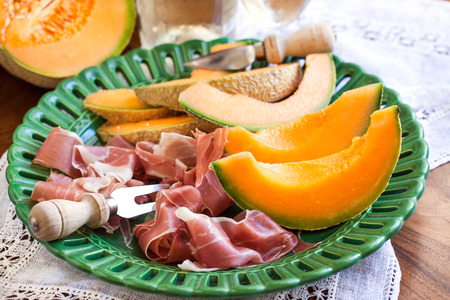 Prosciutto with melon.Traditional Italian appetizer. Stock Photo